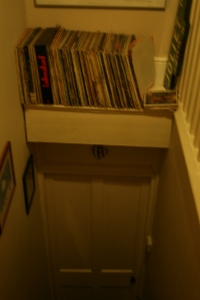 We have so little space in our cottage that the record collection is stored on a shelf above the door.