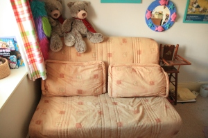 This comfortable sofa bed is 13 years old and was on long term lend to some friends, The wooden highchair to the right has - sort of - been on loan from my older cousin since 1973!