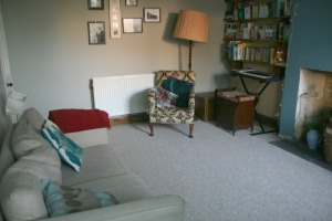 second hand sofa, chair and lamp in sitting room