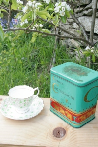 green tea caddy and tea cup