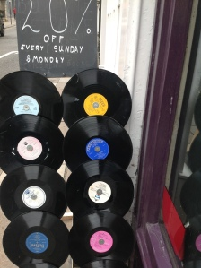 bagging a vinyl bargain at Dorothy House shop, Bath via secondhandtales.wordpress.com