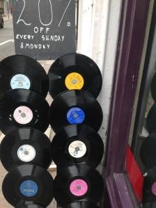 bagging a vinyl bargain at Dorothy House shop, Bath via secondhandtales.wordpress.com