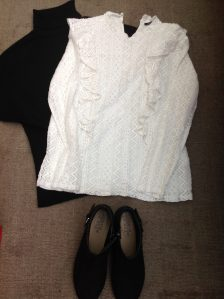 black polo neck and white lace blous